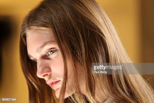 A models waits for a stylist backstage before the start of the Noon By Noor fashion show during New York Fashion Week The Shows September 2016 at The...