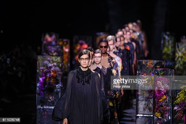 Models walk at the runway during the Dries Van Noten show as part of the Paris Fashion Week Womenswear Spring/Summer 2017 on September 28 2016 in...