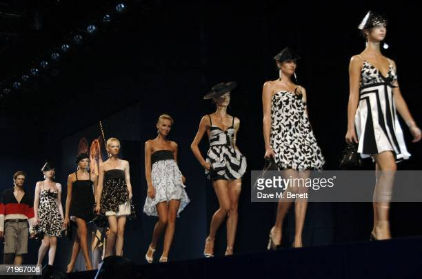Models walk down the catwalk at the fashion show and party to celebrate the launch of Emporio Armani RED collection, at Earls Court on September 21,...