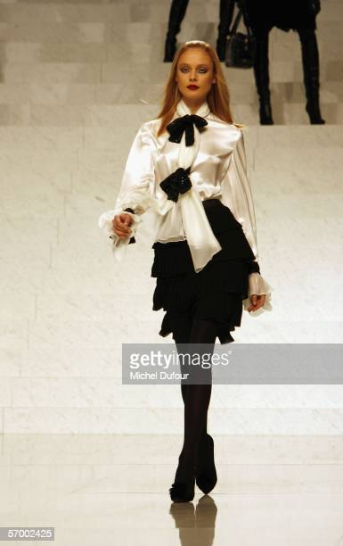 Models walk down the catwalk at the Valentino fashion show as part of Paris Fashion Week Autumn/Winter 2006/7 on March 5, 2006 in Paris, France.
