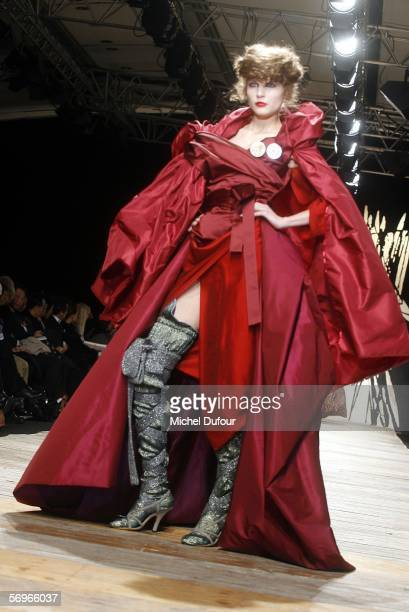 Models walk down the catwalk at the Vivienne Westwood fashion show as part of Paris Fashion Week Autumn/Winter 2006/7 on February 28, 2006 in Paris,...