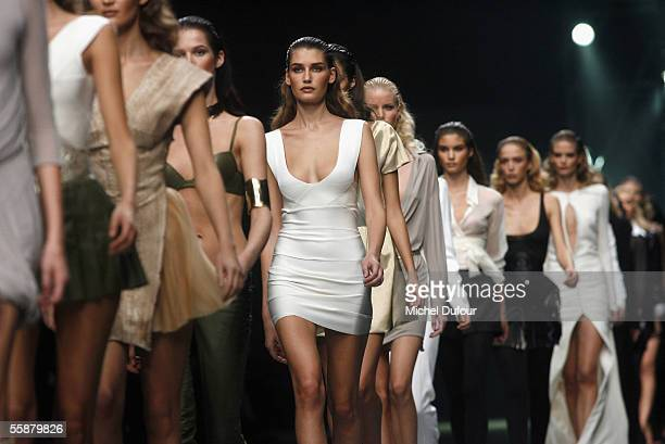 Models walk down the catwalk during the Alexander McQueen show as part of Paris Fashion Week Spring/Summer 2006 on October 7 2005 in Paris France