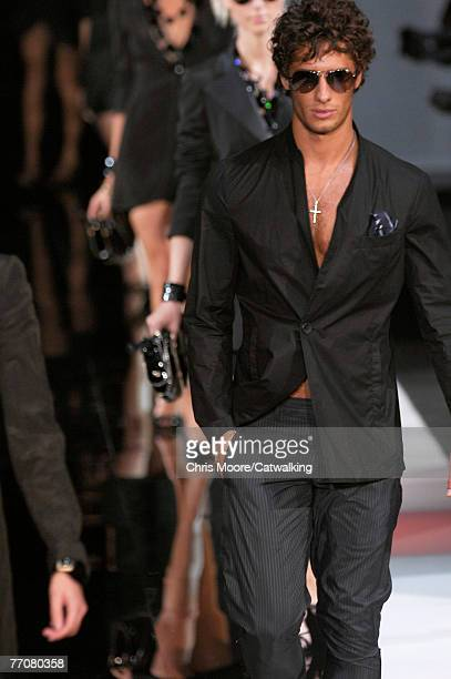 Models walk down the catwalk during the Emporio Armani Spring/Summer 2008 collection part of Milan Fashion Week on September 26, 2007 in Milan, Italy.