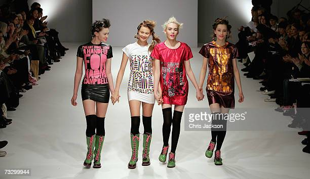 Models walk down the catwalk during the Fashion East show at Bluebird on the Kings Road on February 12 2007 in London England