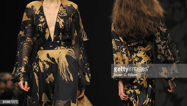 Models walk down the catwalk during the Ossie Clarke show as part of London Fashion Week a/w 2009 at the BFC Tent Natural History Museum on February...