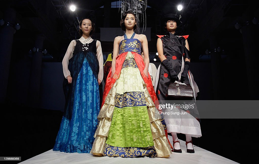 Models walk down the catwalk during the South Korean Traditional Costume 'HanBok' fashion show on October 21, 2011 in Seoul, South Korea. Hanbok is the traditional Korean dress. It is often characterized by vibrant colors and simple lines without pockets. Although the term literally means 'Korean clothing', hanbok today often refers specifically to hanbok of Joseon Dynasty and is worn as semi-formal or formal wear during traditional festivals and celebrations.
