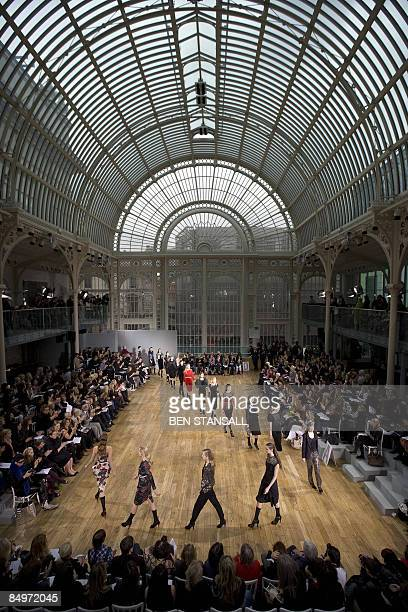 Models walk down the catwalk wearing clothes by designer Nicole Farhi part of the Autumn/Winter 2009 collection on the third day of London Fashion...