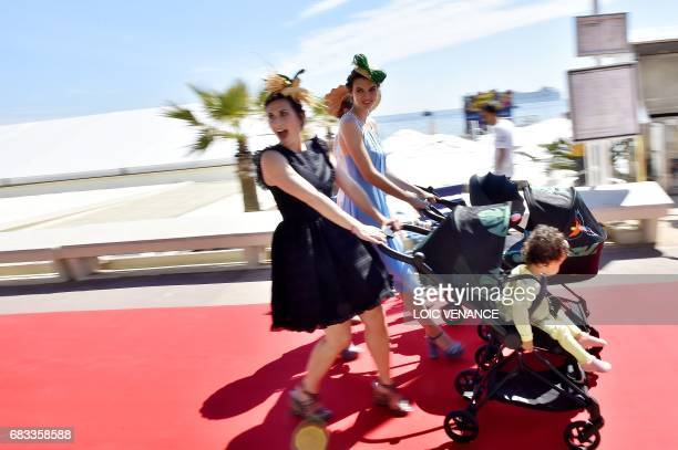 Models walk down the Croisette on May 15 2017 in Cannes southeastern France two days prior to the opening of the 70th Cannes Film Festival / AFP...
