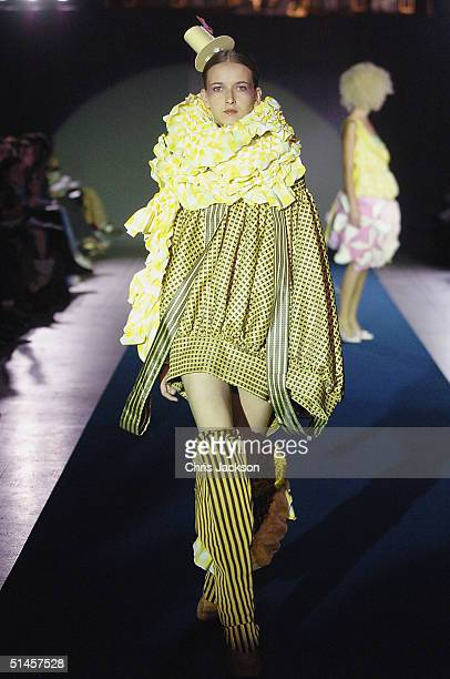 Models walk down the runway at Fashion In Motion'' previewing the latest work by the Central Saint Martin graduates of 2004 at the Victoria and...