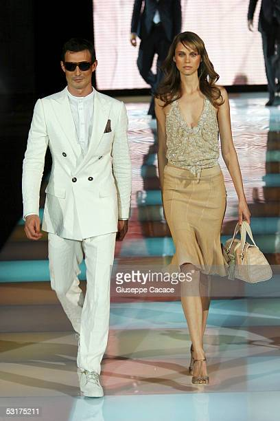 Models walk down the runway at Giorgio Armani show as part of Milan Menswear Week Spring/Summer 2006 on June 30 2005 in Milan Italy