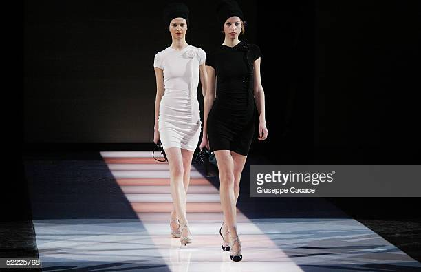 "Models walk down the runway at the Emporio Armani fashion show as part of Milan Fashion Week Autumn/Winter 2005/06 at ""Armani Theatre"" on February..."