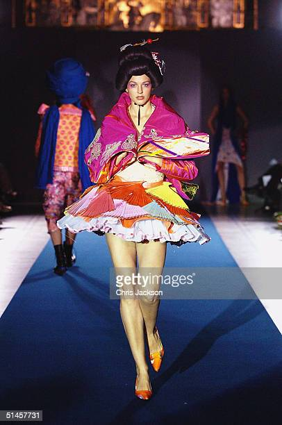 Models walk down the runway at the Fashion In Motion'' catwalk show previewing the latest work by the Central Saint Martin graduates of 2004 at the...