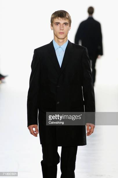 e09d96ebf Models walk down the runway at the Jil Sander show as part of Milan  Menswear Spring