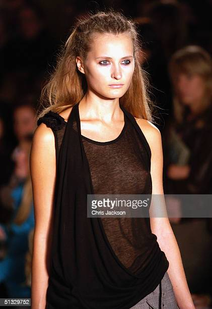 Models walk down the runway at the John Rocha fashion show as part of London Fashion Week Spring/Summer 2005 at Claridge's on September 20 2004 in...