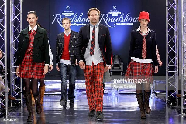 Models walk down the runway at the Peek Cloppenburg Fashion Week Roadshow at Peek Cloppenburg flagship store on September 15 2009 in Berlin Germany