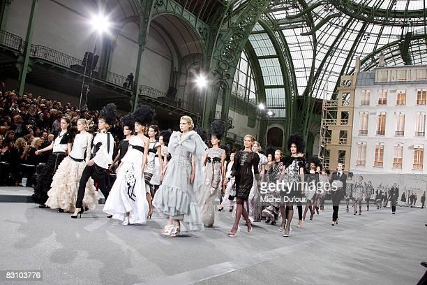 Models walk down the runway during the Chanel PFW Spring Summer 2009 show at Paris Fashion Week 2008 at Grand Palais on October 3 2008 in Paris France