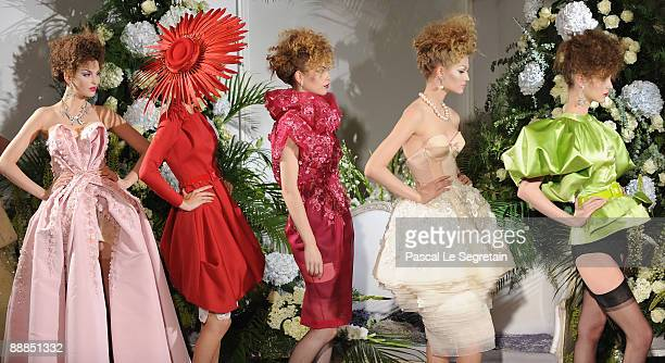 Models walk down the runway during the Christian Dior Haute Couture fashion show for A/W 2009/10 on July 6 2009 in Paris France