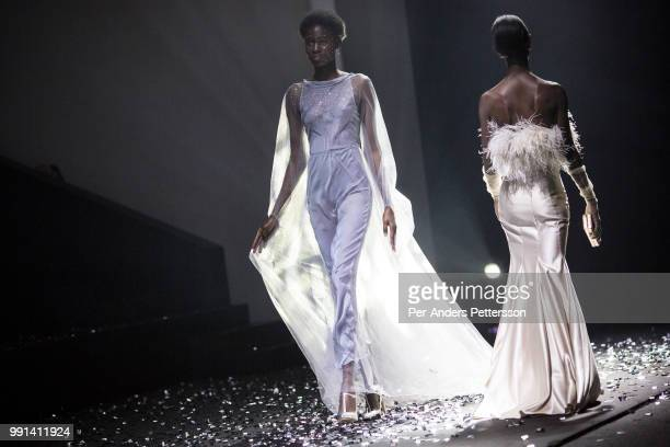 Models walk during a show with the South African designers KLuk CGDT on August 17 2017 in Mall of Africa north of Johannesburg South Africa African...