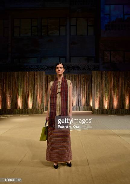 Models walk in garments created by fifteen Indian designers from textiles made by women from selfhelp groups across Asia at the World Bank...