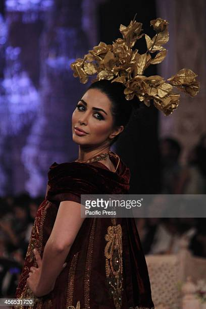 Models walk on a ramp to present the creations of a famous Pakistani designer during the second day of the Pakistan Fashion Design Council Bridal...