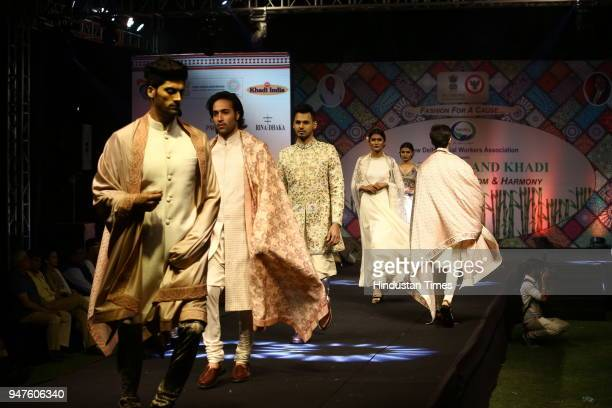 Models walk on ramp during the Fashion Show to promote Ahimsa Silk and Khadi on April 1 2018 in New Delhi India
