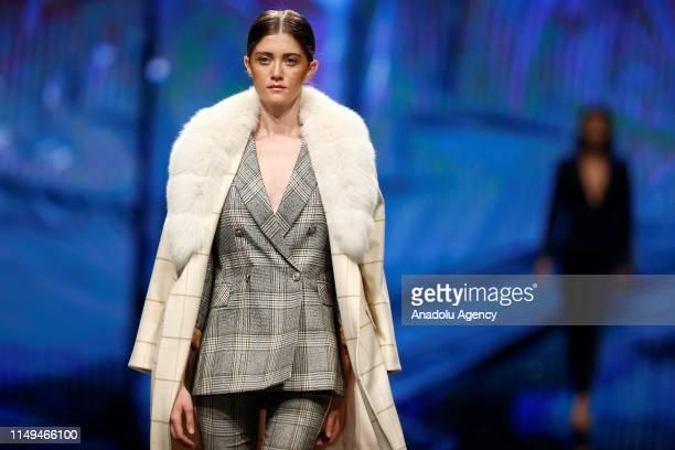 Models walk on runway at Dosso Dossi Fashion Show in Antalya, Turkey on June 12, 2019.