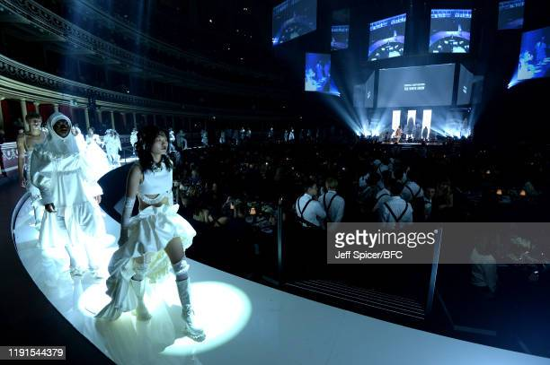 Models walk on stage during The Fashion Awards 2019 held at Royal Albert Hall on December 02 2019 in London England