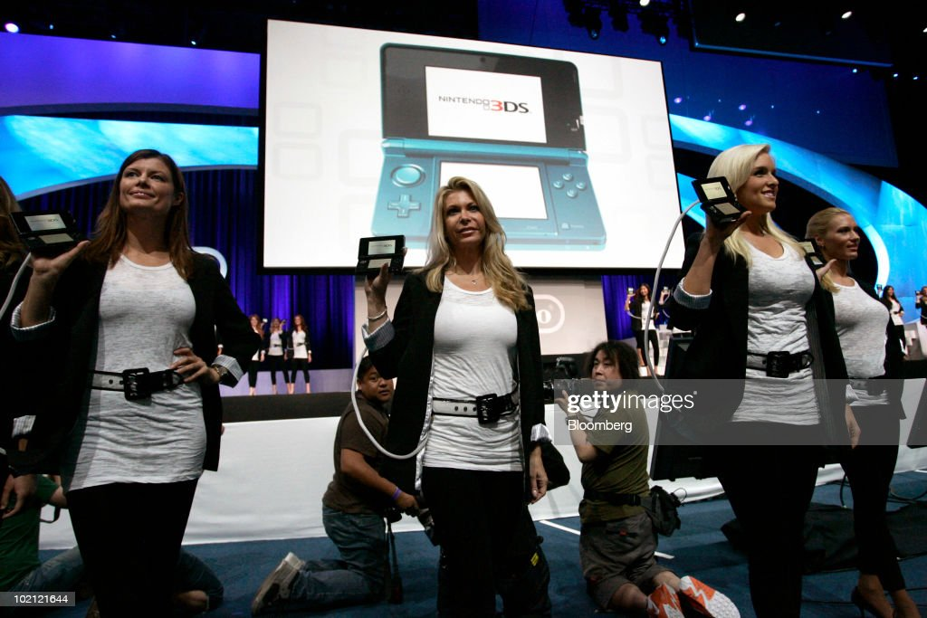 Models walk on stage with Nintendo Co.'s new 3DS game at the Electronic Entertainment Expo (E3) in Los Angeles, California, U.S., on Tuesday, June 15, 2010. Nintendo unveiled a 3-D portable game player today, betting the technology that helped 'Avatar' break box-office records will also be popular on screens small enough to fit in one's pocket. Photographer: Jonathan Alcorn/Bloomberg via Getty Images
