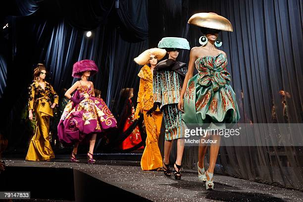 Models walk on the catwalk at the Christian Dior Fashion show during Paris Fashion Week SpringSummer 2008 at Polo de Paris on January 21 2008 in...