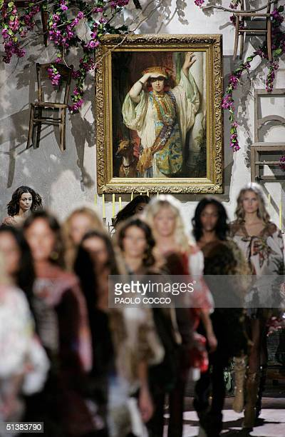 Models walk on the catwalk at the end of Roberto Cavalli's Spring-Summer 2005 women's collection at Milan fashion week 02 October 2004. AFP...