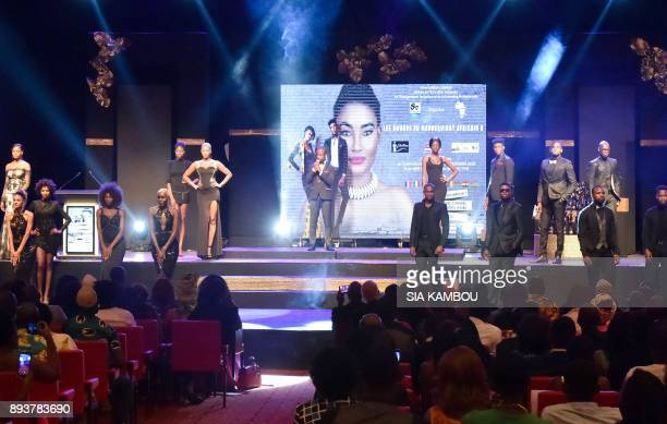 Models walk on the catwalk during the 8th African Model Exhibition Awards on December 15 in Abidjan / AFP PHOTO / SIA KAMBOU