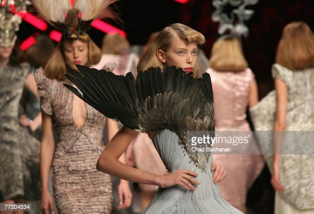 Models walk on the catwalk during the Alexander McQueen Spring/Summer 2008 fashion show at the Salle Marcel Cerdan on October 5 2007 in Paris France