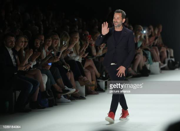 Models walk on the catwalk during the fashion show of the label 'Dimitri' by the Greek-Italian designer Dimitrios Panagiotopoulos at Mercedes-Benz...
