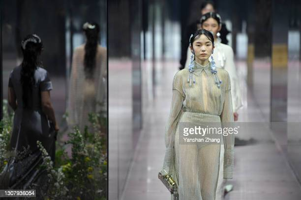 Models walk on the runway at Fendi 2021 Spring/Summer Haute Couture Show on March 19, 2021 in Shanghai, China.