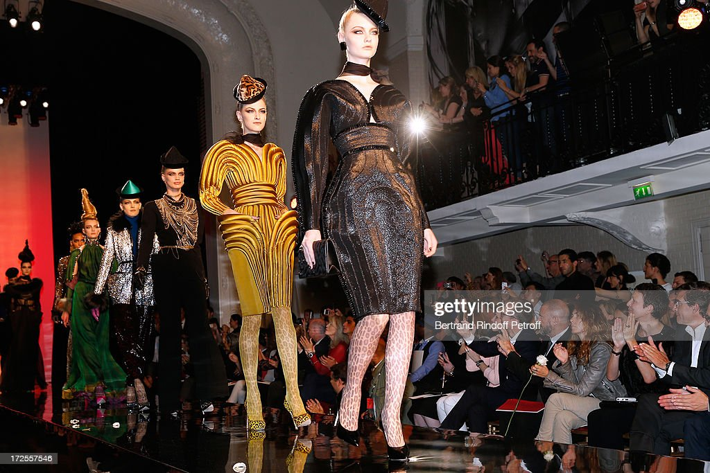 Models walk on the runway during the Jean Paul Gaultier show as part of Paris Fashion Week Haute-Couture Fall/Winter 2013-2014 at 325 Rue Saint Martin on July 3, 2013 in Paris, France.