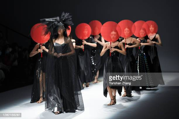 Models walk on the runway during the SGM ART.MOUSE JI Show on day two of China Fashion Week at 751D.PARK on October 25, 2020 in Beijing, China.