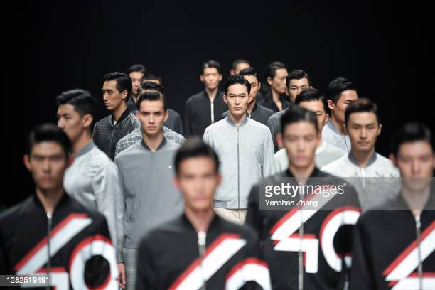 Models walk on the runway of the K-BOXING Show on day 4 of China Fashion Week at 751D.PARK on October 27, 2020 in Beijing, China.