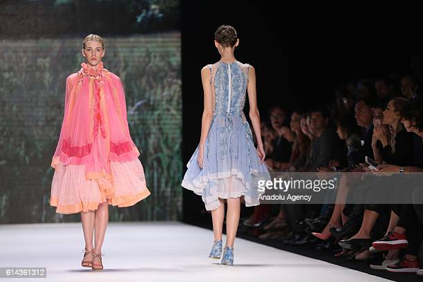 Models walk on the stage as they present the designer Bora Aksu's collection during the Mercedes-Benz Fashion Week Spring/Summer 2017 at the Zorlu...