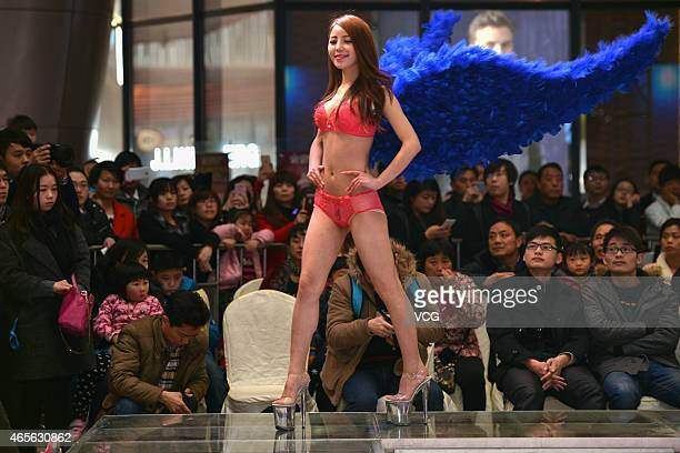 Models walk on the stage during Women's Day at a mall on March 8 2015 in Wuhan Hubei province of China Chinese version of Victoria's Secret Show was...
