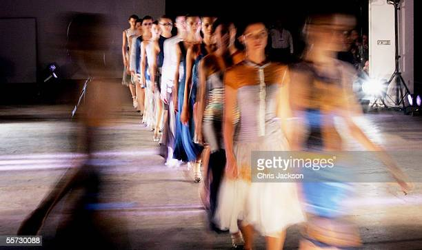Models walk out at the end of the Jonathan Saunders fashion show as part of London Fashion Week Spring/Summer 2006 at the Z Rooms on September 20...