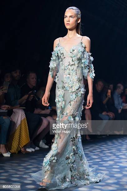 Models walk runway during the Marchesa show September 2016 New York Fashion Week at The Dock, Skylight at Moynihan Station on September 14, 2016 in...