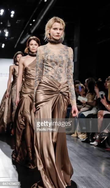 Models walk runway for Dennis Basso FW17 collection runway show during New York Fashion Week at Skylight Clarkson Sq Manhattan