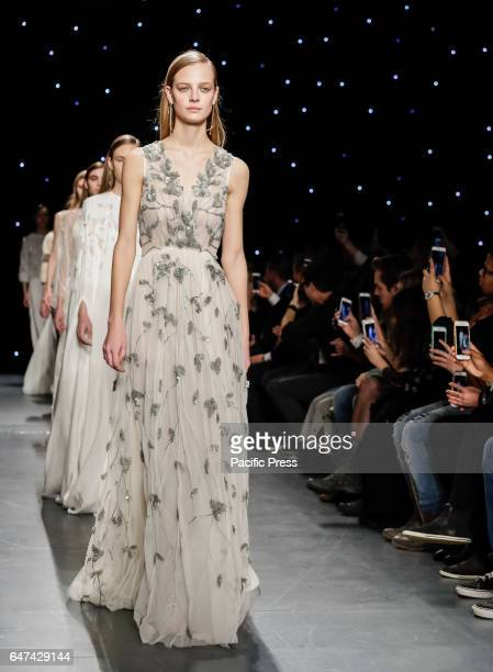 Models walk runway for Oday Shakar Fall/Winter 2017 collection runway show during New York Fashion Week at Pier 59 Studios Manhattan