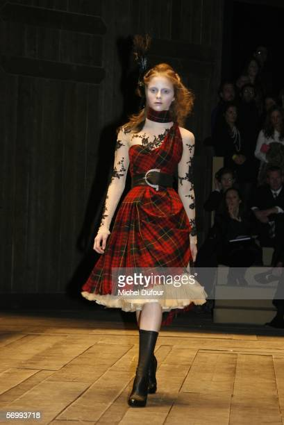 Models walk the catwalk at the Alexander McQueen fashion show at Paris Fashion Week Autumn/Winter 2006/7 on March 3, 2006 in Paris, France.