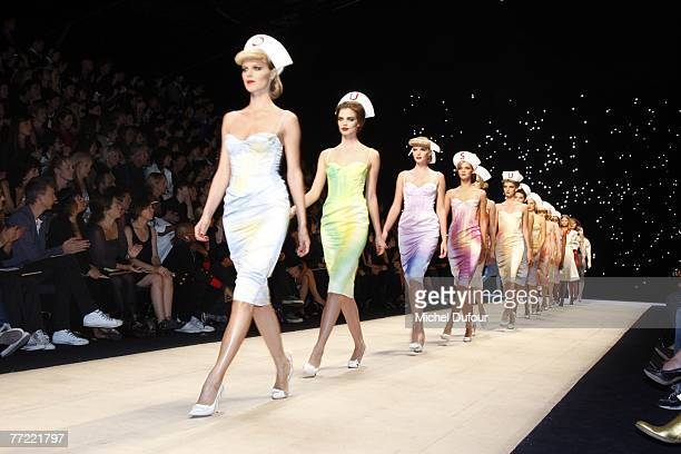 Models walk the catwalk at the Louis Vuitton fashion show during the Spring/Summer 2008 ready-to-wear collection show at Cour carree du Louvre on...