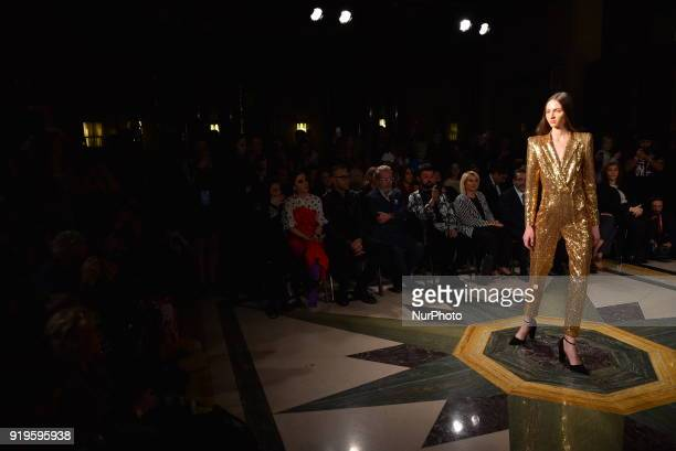 Models walk the catwalk at the Zynep Kartal runway during London Fashion Week February 2018 at Freemasons Hall London on February 17 2018
