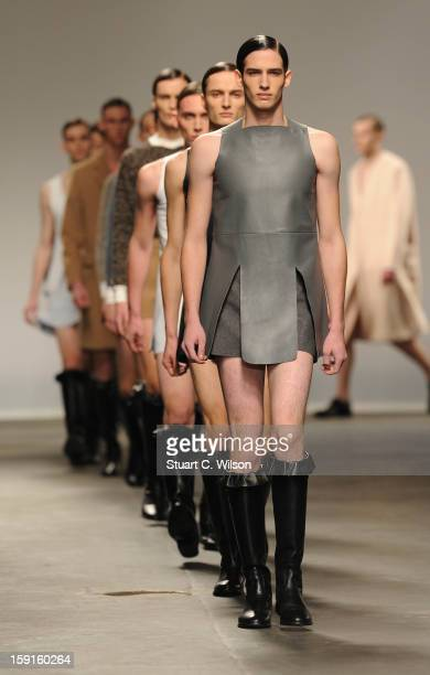 Models walk the catwalk during the J.W. Anderson show at the London Collections: MEN AW13 at The Old Sorting Office on January 9, 2013 in London,...