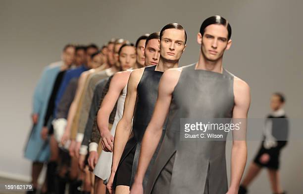 Models walk the catwalk during the JW Anderson show at the London Collections MEN AW13 at The Old Sorting Office on January 9 2013 in London England