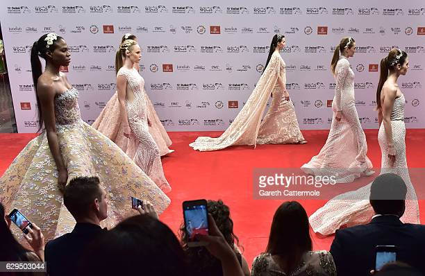 Models walk the red carpet at the Michael Cinco show during D3 Presents DIFF Fashion Forward on day seven of the 13th annual Dubai International Film...