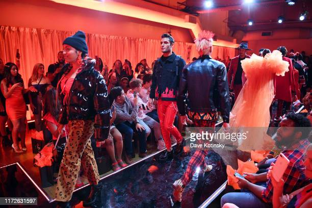 Models walk the runway as Cheetos unveiled faninspired versions of the #CheetosFlaminHaute look at The House Of Flamin' Haute Runway Show Style Bar...
